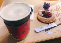Hot latte and raspberry pie
